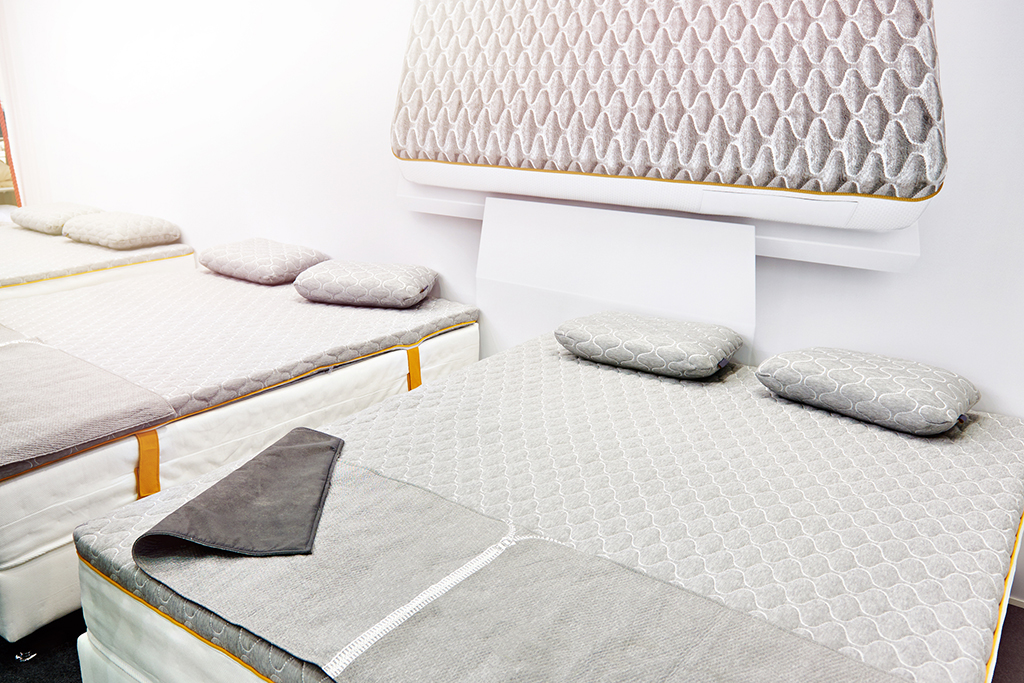 Gray mattress on a double bed in store