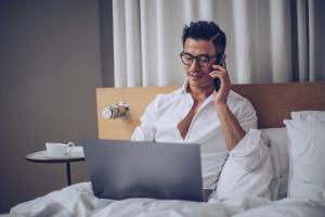 Man working in bedroom