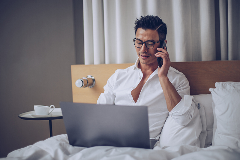 Man working in hotel room