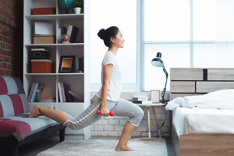women exercising in bed in the morning
