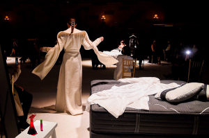 Coco Rocha poses on the runway during the Christian Siriano FW2021 NYFW Show next to Beautyrest mattress