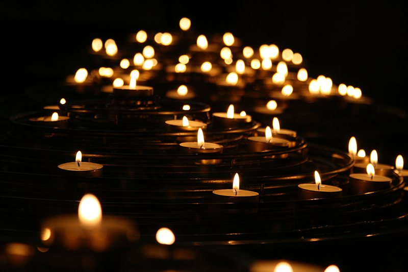 grief and sleep - lit candles